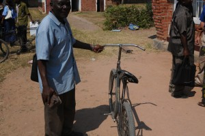 This pastor is the Secretary of the North Katanga Annual Conference, the largest in the UMC;  and this is his bicycle!
