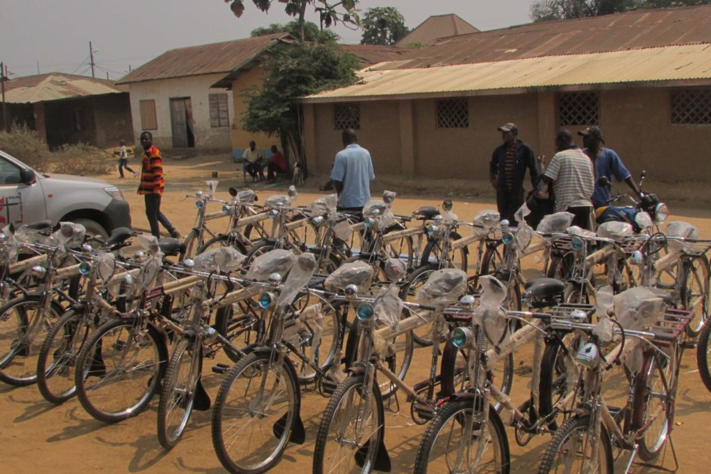 Bishop Unda presenting bicycles and motorcycles at the 2016 Annual Conferences in the East Congo Episcopal area.