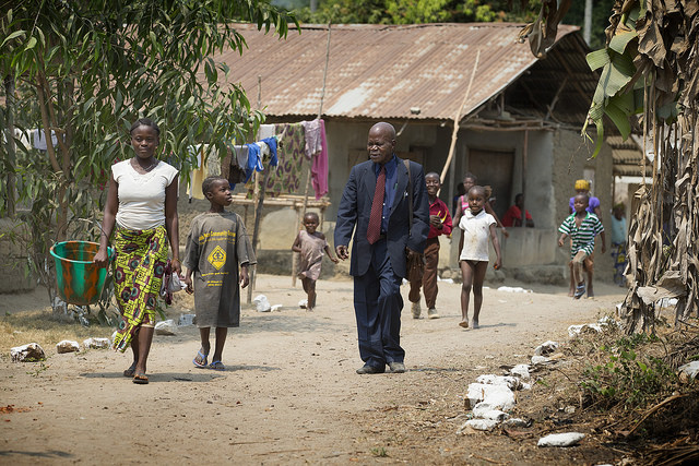 United Methodist Pastor Moses Sandy walks between the two churches near Bo, Sierra Leone, that he will lead in worship this Sunday. Photo by Mike DuBose, UMNS