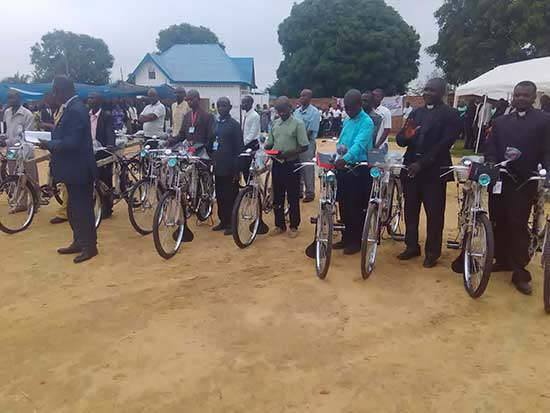 Bishop Unda with the 2017 recipients of bicycles and bibles