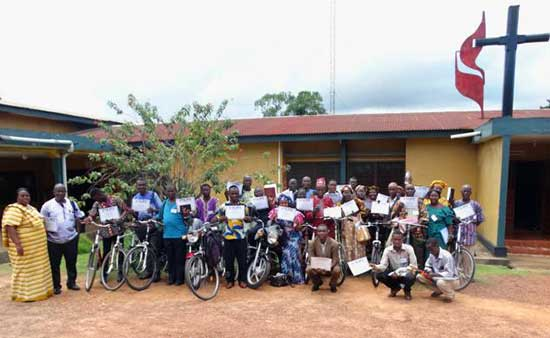 These recipients also attended a three-day training sponsored by International Leadership Institute. Here they show their certificates of completion and the bicycles and bibles received.